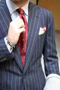 Luca-Rubinacci-pin-stripe-suit-red-tie-wrist-style